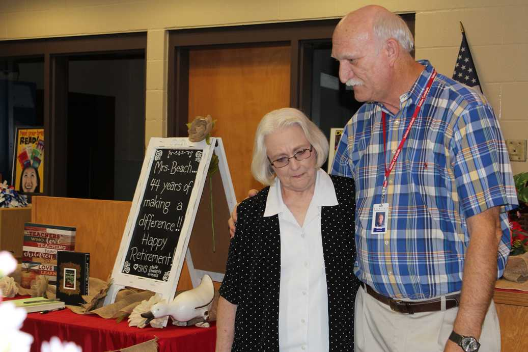 Mrs. Libby Beach retires after 44 years of teaching. She is congratulated by high school principal, Eddie Shawn.
