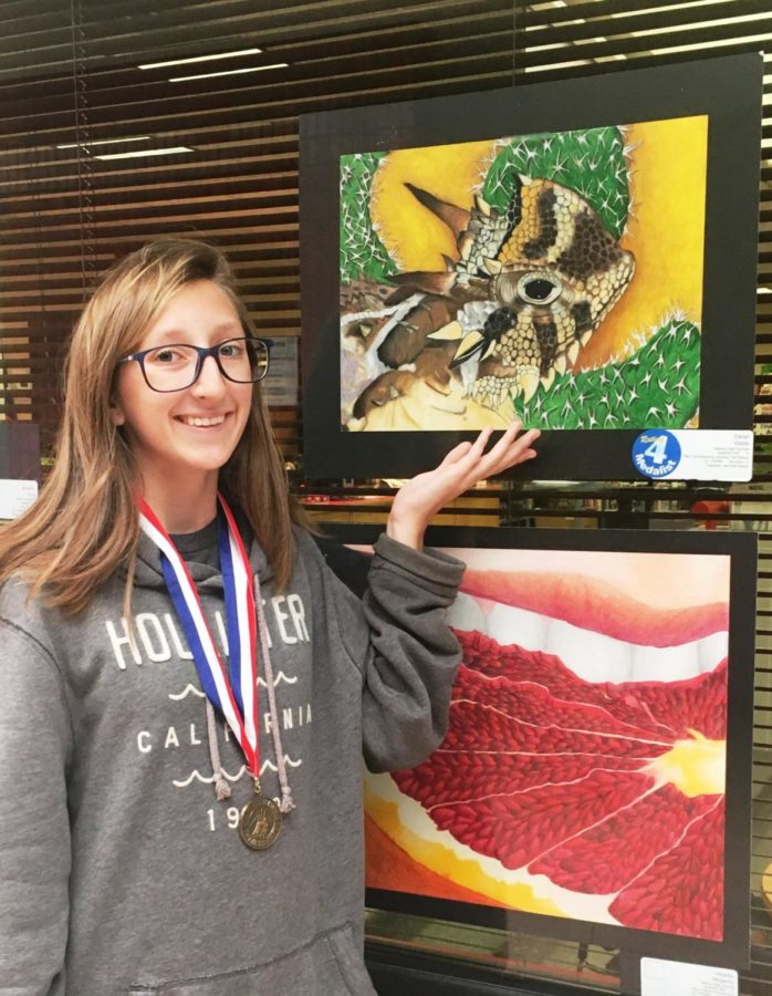 Sarah+Webb+displays+her+winning+art+piece.+Webb+placed+first+at+the+State+VASE+competition.