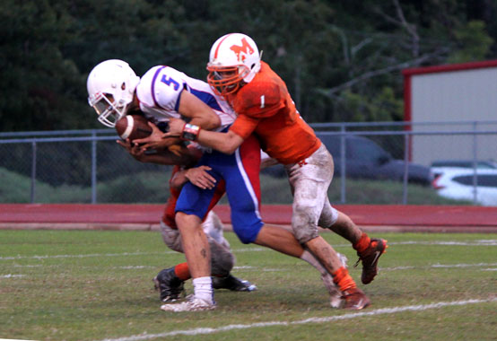 JV football beat Mineola Oct. 25, 48-0, at a muddy home game. Sophomore Kaden Manning fights to get in the endzone after a catch.  JV and varsity were on a roll in the middle of the season with some big wins.