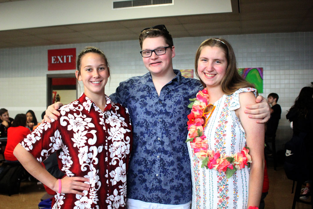 Juniors Shelby Henson and Jake Knight dress up with senior Elena Miller for Tuesday's