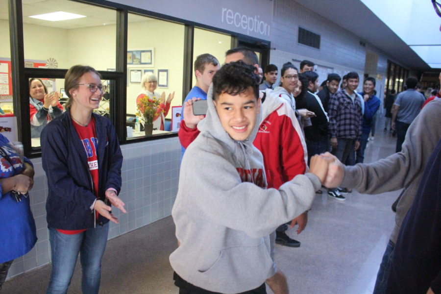 The+student+body+does+a+sendoff+for+the+two+CC+runners+who+made+it+to+state%2C+sophomore+David+Robinson+and+pictured+here+junior+Saniel+Acosta