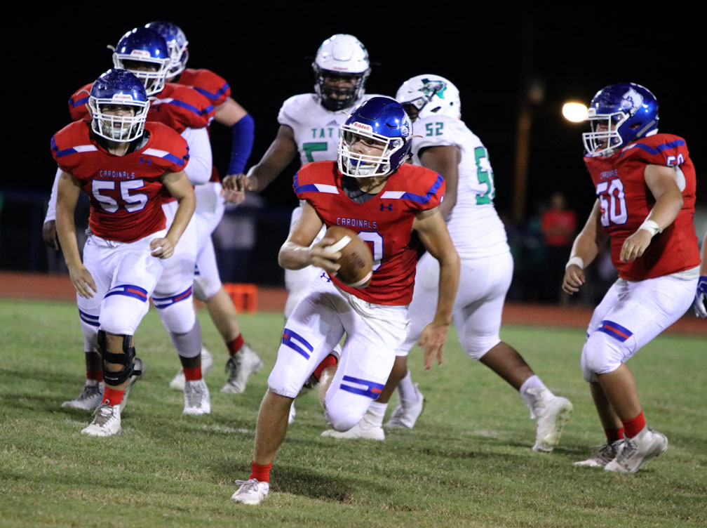 Junior Landon McKinney escapes the pocket to outrun the West Rusk defense.