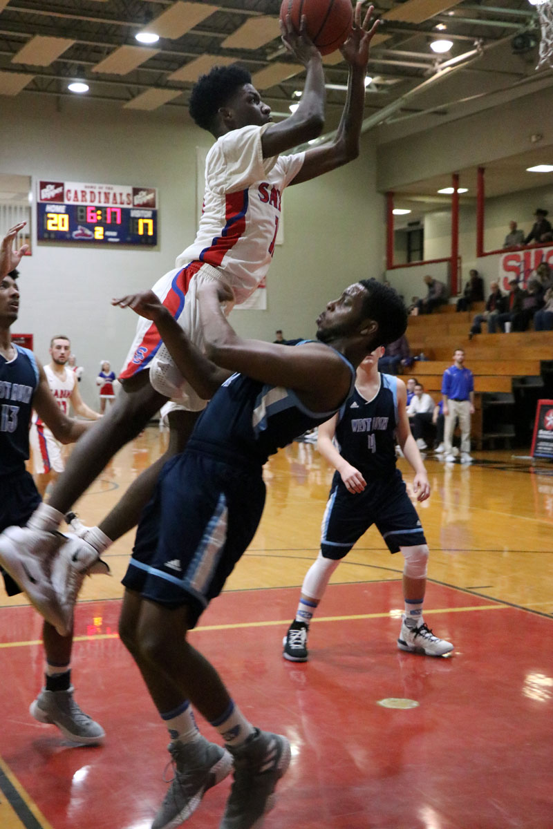 Senior Travion Oliver goes up strong against a West Rusk player during the final district game of the season Feb. 12. The boys will start playoff competition Tuesday, Feb. 19 at LeTourneau University.