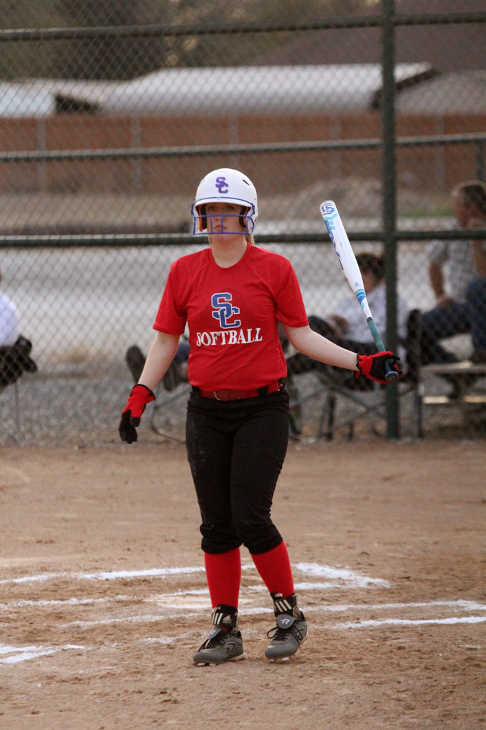 Senior Calleigh King waits to get a sign from her third base coach in the Canton game.