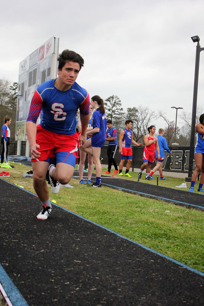 Brannigan Willige competes in the long jump at the Spring Hill meet March 7.