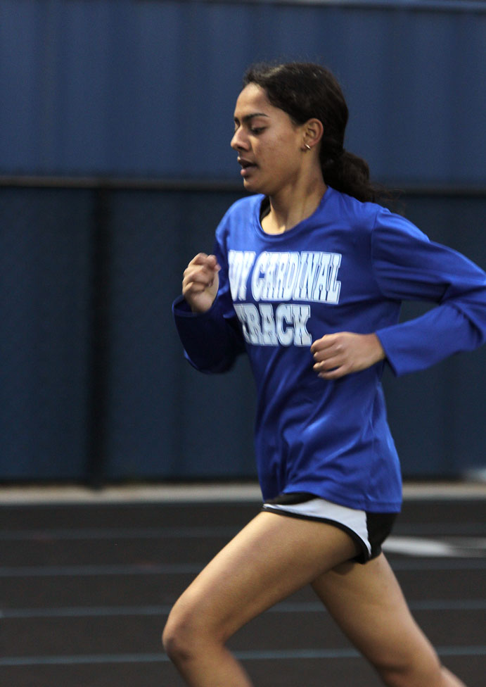 Ruby Torres runs long distance at the Spring Hill Relays.