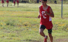 Senior Saniel Acosta runs in the district cross country meet at LeTourneau University Oct. 9.