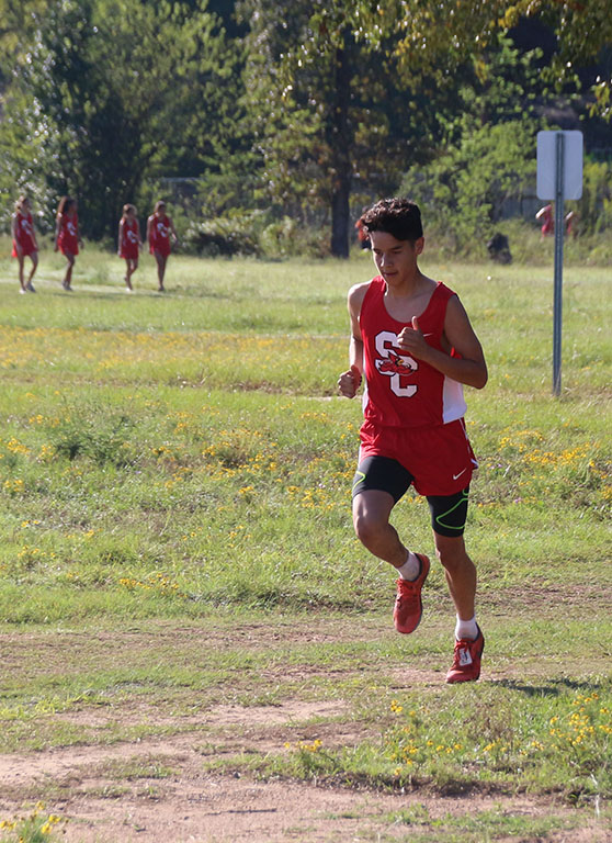 Senior+Saniel+Acosta+runs+in+the+district+cross+country+meet+at+LeTourneau+University+Oct.+9.+