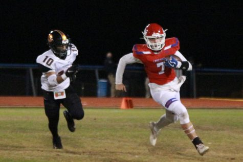 At the senior night game against Gladewater, junior quarterback Jace Burns runs towards the end zone Oct. 30.