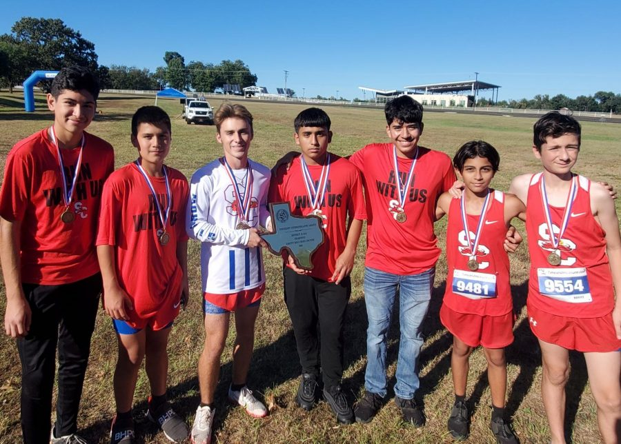 At the district cross country meet, the boys team show off their first place plague Oct. 11.